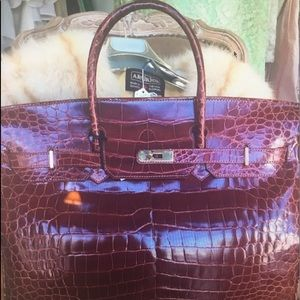 Birkin style authentic crocodile wine bag.